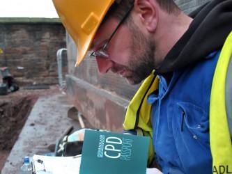 Headland Worker Reading Information